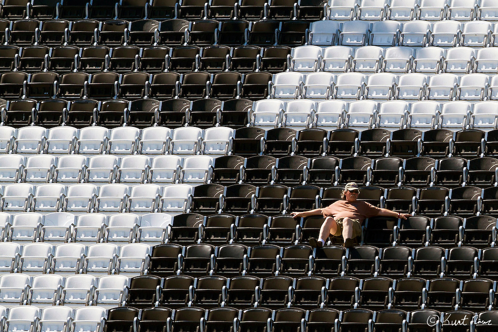 A fan watches the race in the stands during the Daytona 200 at Daytona International Speedway on March 17, 2012