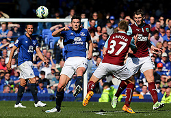 Everton's Gareth Barry challenges Burnley's Scott Arfield  - Photo mandatory by-line: Matt McNulty/JMP - Mobile: 07966 386802 - 18/04/2015 - SPORT - Football - Liverpool - Goodison Park - Everton v Burnley - Barclays Premier League