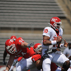Apr 18, 2009; Piscataway, NJ, USA; Rutgers QB D.C. Jefferson (10) is dragged down by DL Andre Civil (97) during the first half of Rutgers' Scarlet and White spring football scrimmage.