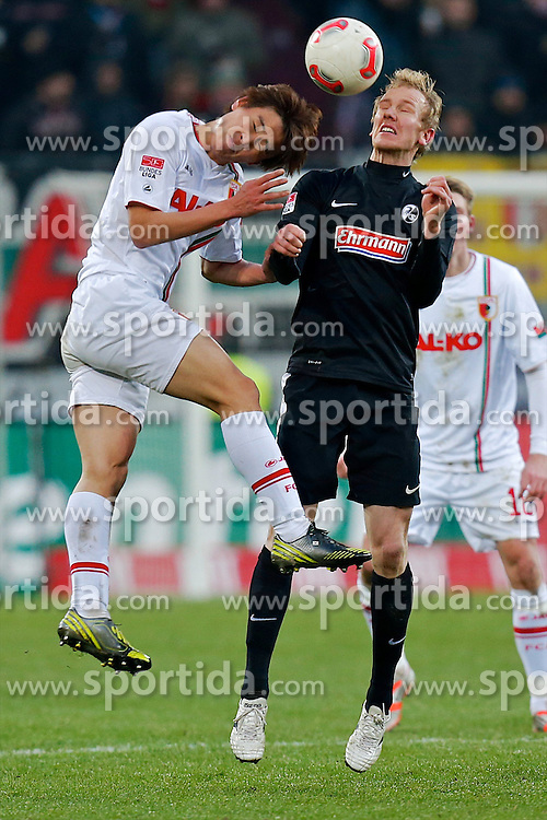 01.12.2012, SGL Arena, Augsburg, GER, 1. FBL, FC Augsburg vs SC Freiburg, 15. Runde, im Bild Kopfballduell zwischen Ja-Cheol Koo (# 14, FC Augsburg) und Jan Rosenthal (# 8, SC Freiburg) v.l // during the German Bundesliga 15th round match between FC Augsburg and SC Freiburg at the SGL Arena, Augsburg, Germany on 2012/12/01. EXPA Pictures © 2012, PhotoCredit: EXPA/ Eibner/ Peter Fast..***** ATTENTION - OUT OF GER *****