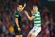 Kieran Tierney (#63) of Celtic protests as referee Andrew Dallas gives a foul against him during the Betfred Cup Final between Celtic and Aberdeen at Celtic Park, Glasgow, Scotland on 2 December 2018.