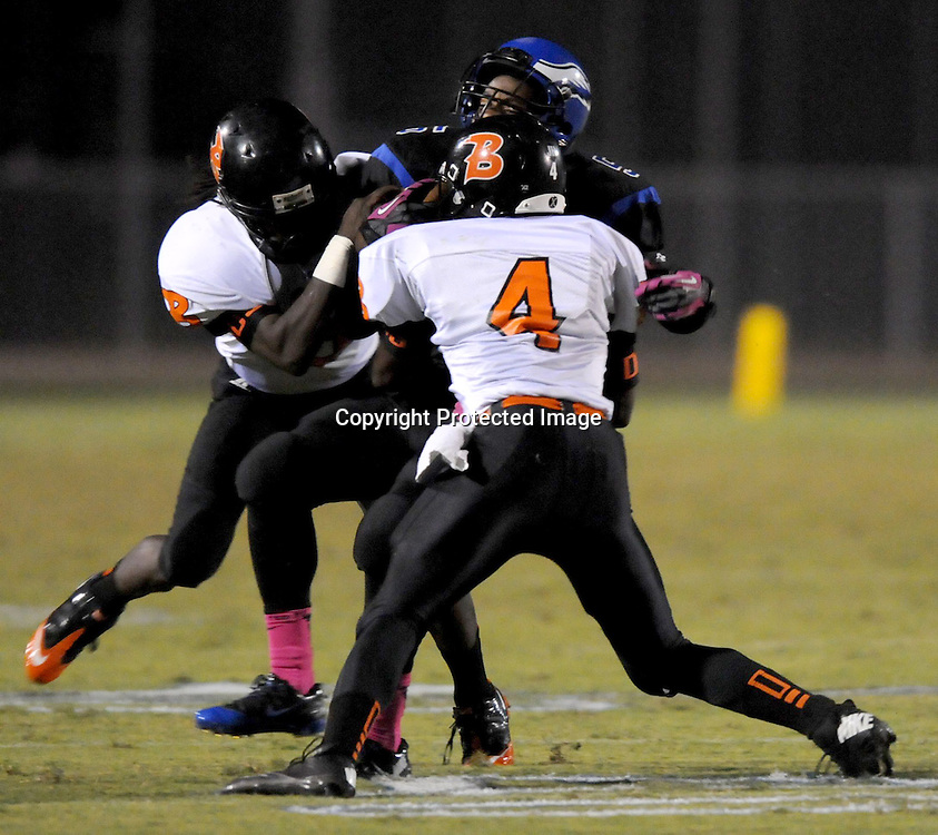 Wallace-Rose Hill's Keyshawn Cannady and Johnnie Glaspie tackle East Bladen's Jaquan Jones. (Jason A. Frizzelle)