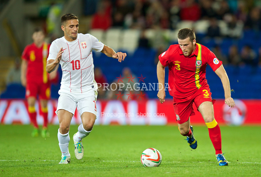 CARDIFF, WALES - Tuesday, September 10, 2013: Wales' Adam Matthews in action against Serbia's Dusan Tadic during the 2014 FIFA World Cup Brazil Qualifying Group A match at the Cardiff CIty Stadium. (Pic by David Rawcliffe/Propaganda)