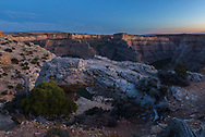 The last rays of the evening highlight the beautiful rock formations at Devil's Canyon overlook.