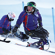 Peter Dunning, Great Britain, during course inspection before his third place finish in the Men's Slalom Sitting, Adaptive Slalom competition at Coronet Peak, New Zealand during the Winter Games. Dunning, who lost both his legs in a roadside bombing attack in Afghanistan three years ago. Winter Games, Queenstown, New Zealand, 25th August 2011. Photo Tim Clayton