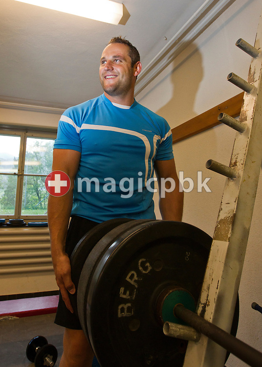 Swiss wrestling star Noeldi (Arnold) FORRER of Switzerland is pictured during weight training in a gym at the former schoolhouse in Stein (SG), Switzerland, Friday, May 6, 2011. (Photo by Patrick B. Kraemer / MAGICPBK)