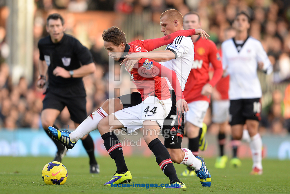 Picture by Andrew Timms/Focus Images Ltd +44 7917 236526<br /> 02/11/2013<br /> Steve Sidwell of Fulham and Adnan Januzaj of Manchester United during the Barclays Premier League match at Craven Cottage, London.