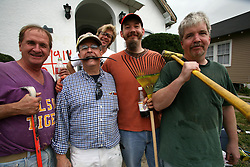 01 Feb 2006. New Orleans, Louisiana. Post Katrina.<br />  (l-r) Shiek, Wesley Schmidt, Craig Klein, Andy Lehman and Bill Phillips of the Arabi Wrecking Krewe help clear a house of mold in the Gentilly neighbourhood. As federal, state and local authorities dither, members of the Arabi Wrecking Krewe, many of them musicians themselves, team up to strip homes of fellow musicians ready to be repaired. To date the Krewe has stripped over 40 homes.  <br /> Photo; Charlie Varley/varleypix.com