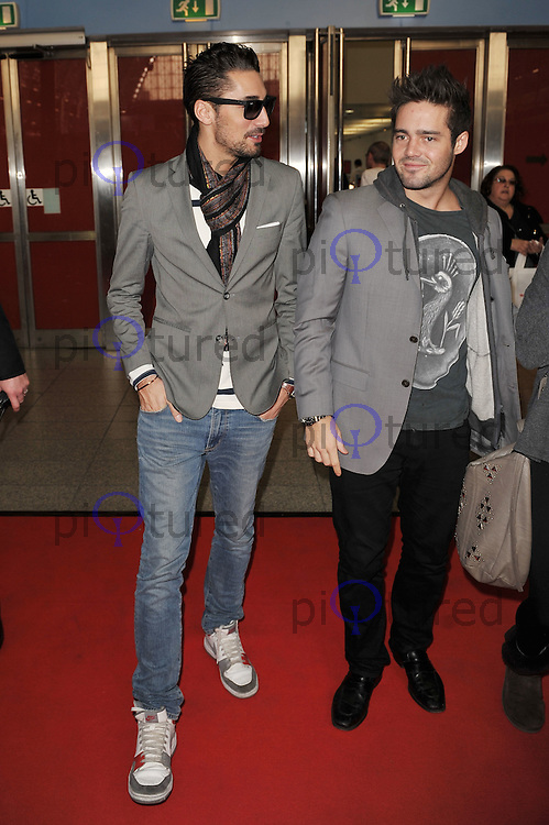 Hugo Taylor and Spencer Matthews ..Attending Erotica 2011, Olympia Hall, Kensington, London, England. 18 November 2011. Contact: rich@piqtured.com  +44(0)7941 079620 (Picture by Awais Butt)