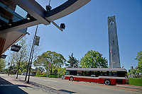 Wolfline bus passes the Belltower and The Aloft Hotel on Hillsborough Street.