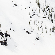 Lynsey Dyer skiing a barbie line in Glacier National Park.