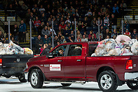 KELOWNA, CANADA - DECEMBER 2: Okanagan Dodge drives off the ice with truck beds full of teddy bears after the annual teddy bear toss at the Kelowna Rockets against the Kootenay Ice on December 2, 2017 at Prospera Place in Kelowna, British Columbia, Canada.  (Photo by Marissa Baecker/Shoot the Breeze)  *** Local Caption ***