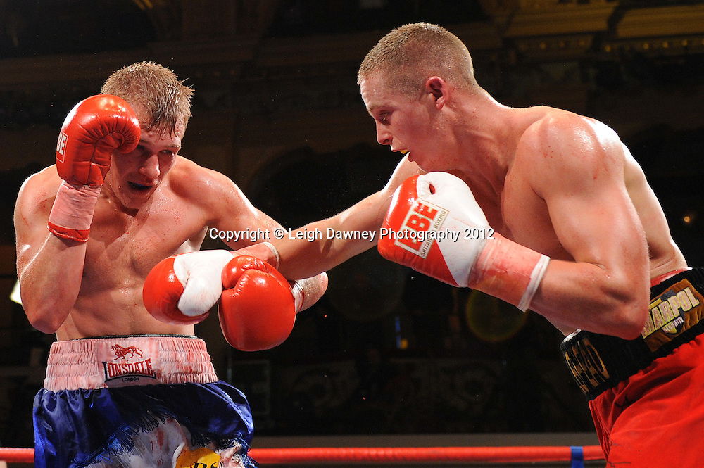 Karl Place (red shorts) defeats Dan Blackwell in a Light Welterweight contest at The Winter Gardens, Blackpool on the 31st March 2012. Frank Maloney and Steve Wood VIP Promotions. © Leigh Dawney Photography 2012.
