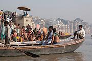 Boats at the bathing ghats on the river Ganges at Varanasi, Uttar Pradesh, India