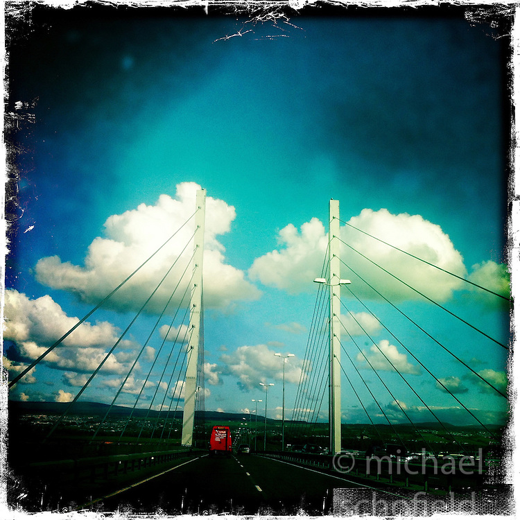 The Kessock Bridge is a cable-stayed bridge across the Beauly Firth, an inlet of the Moray Firth, between the village of North Kessock and the city of Inverness..Hipstamatic images taken on an Apple iPhone..©Michael Schofield.