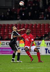 Nottingham Forest's Dele Adebola  Battles for the ball with Bristol City's Steven Caulker - Photo mandatory by-line: Matt Bunn/JMP - 25/01/2011 - SPORT - FOOTBALL - npower championship-Nottingham Forest v Bristol city-City Ground-Nottingham