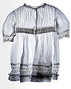 a toddler white dress with embroidery