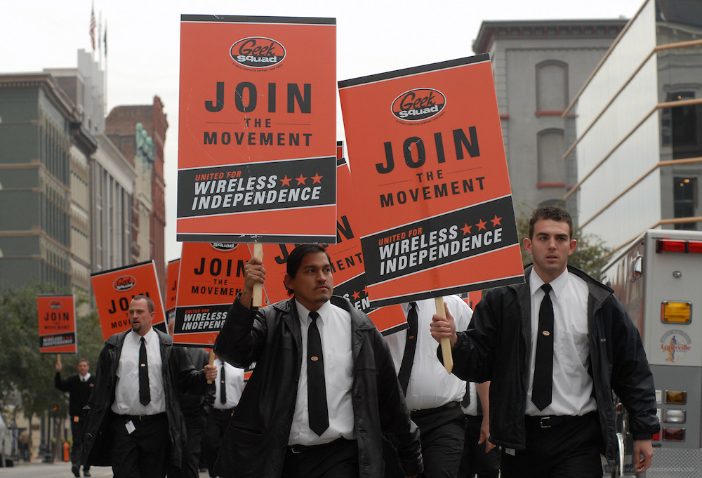PHOTO PROVIDED BY GEEK SQUAD--Geek Squad City agents Cesar Saguay, left, and Todd Eurton march Wednesday, Oct. 25, 2006, to announce a new Wireless Bill of Rights from Geek Squad during an event in Louisville, Ky., to celebrate the opening of Geek Squad City. (Geek Squad/Brian Bohannon)