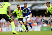 Ipswich Town striker Freddie Sears bears Brighton central midfielder, Dale Stephens during the Sky Bet Championship match between Ipswich Town and Brighton and Hove Albion at Portman Road, Ipswich, England on 29 August 2015.