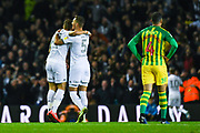 Leeds United defender Gaetano Berardi (28) and Leeds United defender Ben White (5) celebrate Leeds United defender Ezgjan Alioski (10) scoring a goal to make the score 1-0 during the EFL Sky Bet Championship match between Leeds United and West Bromwich Albion at Elland Road, Leeds, England on 1 October 2019.