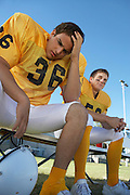 Two Football Players on the Bench
