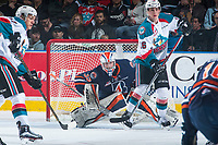 KELOWNA, CANADA - MARCH 31: Calvin Thurkauf #27 and Kole Lind #16 of the Kelowna Rockets look for the pass as Connor Ingram #39 of the Kamloops Blazers defends the net on March 31, 2017 at Prospera Place in Kelowna, British Columbia, Canada.  (Photo by Marissa Baecker/Shoot the Breeze)  *** Local Caption ***
