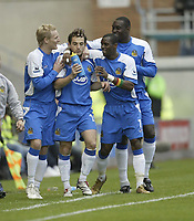Photo: Aidan Ellis.<br /> Wigan Athletic v Manchester United. The Barclays Premiership. 14/10/2006.<br /> Wigan's Leighton Baines celebrates his goal with team mates