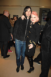BOBBY GILESPIE and PAM HOGG at a private view of Paul Simonon's recent paintings held at Thomas Williams Fine Art, 22 Old Bond Street, London on 15th April 2008.<br /><br />NON EXCLUSIVE - WORLD RIGHTS