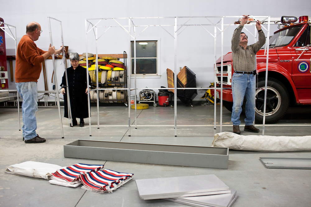 Steve Darrow, Susan Frost, and David Rienzo, from left, assemble voting booths for primary voting at the Grafton Fire Station on Tuesday, January 10, 2012 in Grafton, NH. Brendan Hoffman for the New York Times