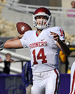 MANHATTAN, KS - OCTOBER 25:  Quarterback Sam Bradford #14 of the Oklahoma Sooners throws the ball down field in the first half against the Kansas State Wildcats on October 25, 2008 at Bill Snyder Family Stadium in Manhattan, Kansas.  The Oklahoma Sooners won 58-35.