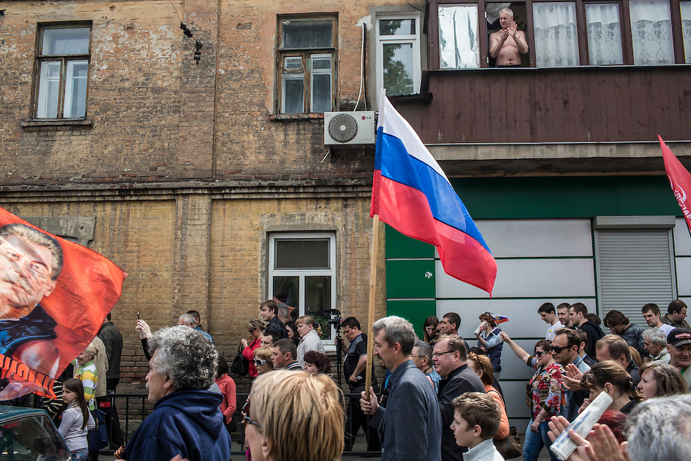 A man watches a pro-Russian march on Thursday, May 1, 2014 in Donetsk, Ukraine.