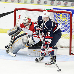 COBOURG, - Dec 15, 2015 -  Game #5 - Canada West vs the United States at the 2015 World Junior A Challenge at the Cobourg Community Centre, ON. Ross Colton #22 of Team United States in the crease as Matthew Murray #31 of Team Canada West follows the play during the first period.(Photo: Tim Bates / OJHL Images)