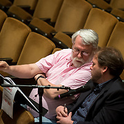 June 3, 2014 - New York, NY : Composer Jesse Jones, foreground, works with mentor composer Christopher Rouse during a rehearsal of Jones's composition by the New York Philharmonic at Avery Fisher Hall on Tuesday. Three works by little-known composers, such as Jones, will be selected for inclusion in the New York Philharmonic's Biennial. CREDIT: Karsten Moran for The New York Times