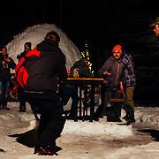 Chris Vargo passes a beer to a spectator at Hostel X Gelande Quaff practice.