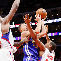 19 November 2015: Golden State Warriors guard Stephen Curry (30) goes for the layup against Los Angeles Clippers guard Wesley Johnson (33) and Los Angeles Clippers center DeAndre Jordan (6) during the Golden State Warriors 124-117 victory over the Los Angeles Clippers, at the Staples Center, Los Angeles, California, USA.