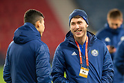 Abat Aymbetov (#17) of Kazakhstan is all smiles on the pitch before the UEFA European 2020 Group I qualifier match between Scotland and Kazakhstan at Hampden Park, Glasgow, United Kingdom on 19 November 2019.