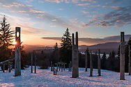 Sunset at the Playground of the Gods (Kamui Mintara) sculptures at the Burnaby Mountain Conservation Area (Burnaby Mountain Park) in Burnaby, British Columbia, Canada.  These carved wooden poles were created by Japanese sculptors Nuburi Toko and Shusei (his son) and are meant to illustrate goodwill between Burnaby and its Japanese sister city Kushiro.