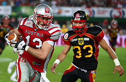 07.06.2014, Ernst Happel Stadion, Wien, AUT, American Football Europameisterschaft 2014, Finale, Oesterreich (AUT) vs Deutschland (GER), im Bild Thomas Haider, (Team Austria, WR, #13) und Baris Atakan, (Team Germany, LB, #33) // during the American Football European Championship 2014 final game between Austria and Denmark at the Ernst Happel Stadion, Vienna, Austria on 2014/06/07. EXPA Pictures © 2014, PhotoCredit: EXPA/ Thomas Haumer