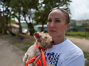 "Chrissy Beckles holds ""Scrappy,"" a small dog just rescued from Guayanes Beach, Puerto Rico."