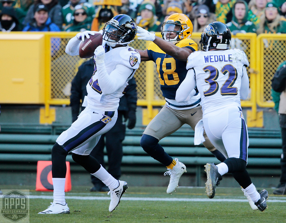 Baltimore Ravens cornerback Jimmy Smith (22) intercepts a Green Bay Packers quarterback Brett Hundley (7) pass intended for Green Bay Packers wide receiver Randall Cobb (18) in the end zone in the 1st quarter. <br /> The Green Bay Packers hosted the Baltimore Ravens at Lambeau Field Sunday, Nov. 19, 2017. STEVE APPS FOR THE STATE JOURNAL.