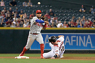 PHOENIX, AZ - JUNE 26:  Andres Blanco #4 of the Philadelphia Phillies turns the double play over the sliding Chris Herrmann #10 of the Arizona Diamondbacks in the second inning at Chase Field on June 26, 2017 in Phoenix, Arizona.  (Photo by Jennifer Stewart/Getty Images)