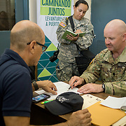 OCTOBER 20 - SANTA ISABEL, PUERTO RICO - <br /> Santa Isabel mayor Enrique Questell Alvarado, left,  and 105th Engineer Battalion Lt. Coronel Cale Moody, go over maps showing areas the town needs help from the US Military in.<br /> (Photo by Angel Valentin/Freelance)