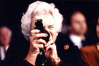 Barbara Bush taking a light reading of me - Photograph by Owen Franken