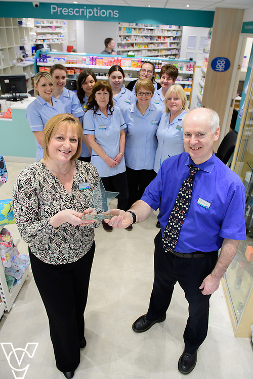 Lincolnshire Co-operative's Celebrating Success Evening winners.  Louth Pharmacy was awarded Pharmacy Branch of the Year.  Pictured is manager Amanda Hissey and dispensary team leader Steve Vincent holding the award, with colleagues, from left, Elaine Bushell, Alice Cope, Lauren Taylor, Elayne Dunham, Helen Atkinson, Carol Ward (front), Vickie Crofts (back), Debbie Standland and Yvonne Andrews.<br /> <br /> Picture: Chris Vaughan Photography for Lincolnshire Co-op<br /> Date: March 24, 2017