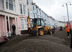© London News Pictures. 07/01/2014. Aberystwyth, UK.<br /> Workmen and residents begin the long process of clearing debris and damaged on the seafront at Aberystwyth, Wales, caused by a storm which battered the East coast of the UK and Ireland. Photo credit: Keith Morris/LNP