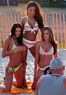 "ATLANTIC CITY, NJ - JUNE 27: From left, Stuff Magazine Model Search winners, Christina Kraft, Danielle Marcos, Eva Kirchstein are photographed by Charlie Langella during the Maxim Magazine Presents ""Fantasy Island"" at the Borgata Hotel Casino and Spa June 27, 2004 in Atlantic City, New Jersey. The event consisted of two music stages and four unique themed areas, providing a wide array of entertainment for guests; South Beach Venice Beach, Stuffland, and The Oasis. (Photo by William Thomas Cain/Getty Images)"