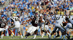 Texas A&M defensive lineman Myles Garrett (15) fights his way around UCLA offensive lineman Kenny Lacy (76) during the fourth quarter of an NCAA college football game against Saturday, Sept. 3, 2016, in College Station, Texas. Texas A&M won 31-24 in overtime. (AP Photo/Sam Craft)
