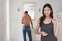 Woman and man getting ready in bathroom
