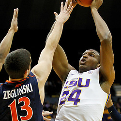 January 2, 2012; Baton Rouge, LA; LSU Tigers forward Storm Warren (24) shoots over Virginia Cavaliers guard Sammy Zeglinski (13) during the first half of a game at the Pete Maravich Assembly Center.  Mandatory Credit: Derick E. Hingle-US PRESSWIRE