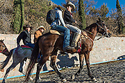 Young Mexican cowboys begin the final ride to the Cristo Rey shrine on Cubilete Mountain during the annual Cabalgata de Cristo Rey pilgrimage January 6, 2017 in Guanajuato, Mexico. Thousands of Mexican cowboys and horse take part in the three-day ride to the mountaintop shrine of Cristo Rey.